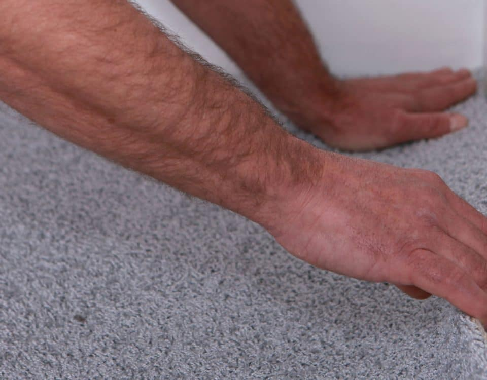 Man installing carpet