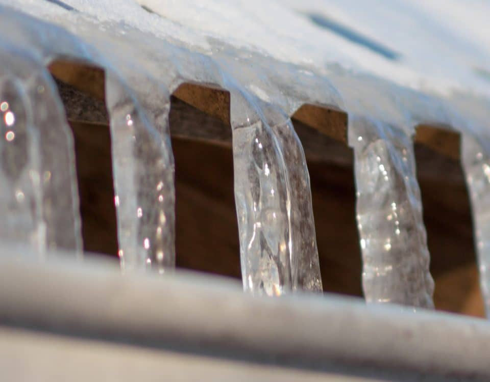 Icicles growing from roof into gutter